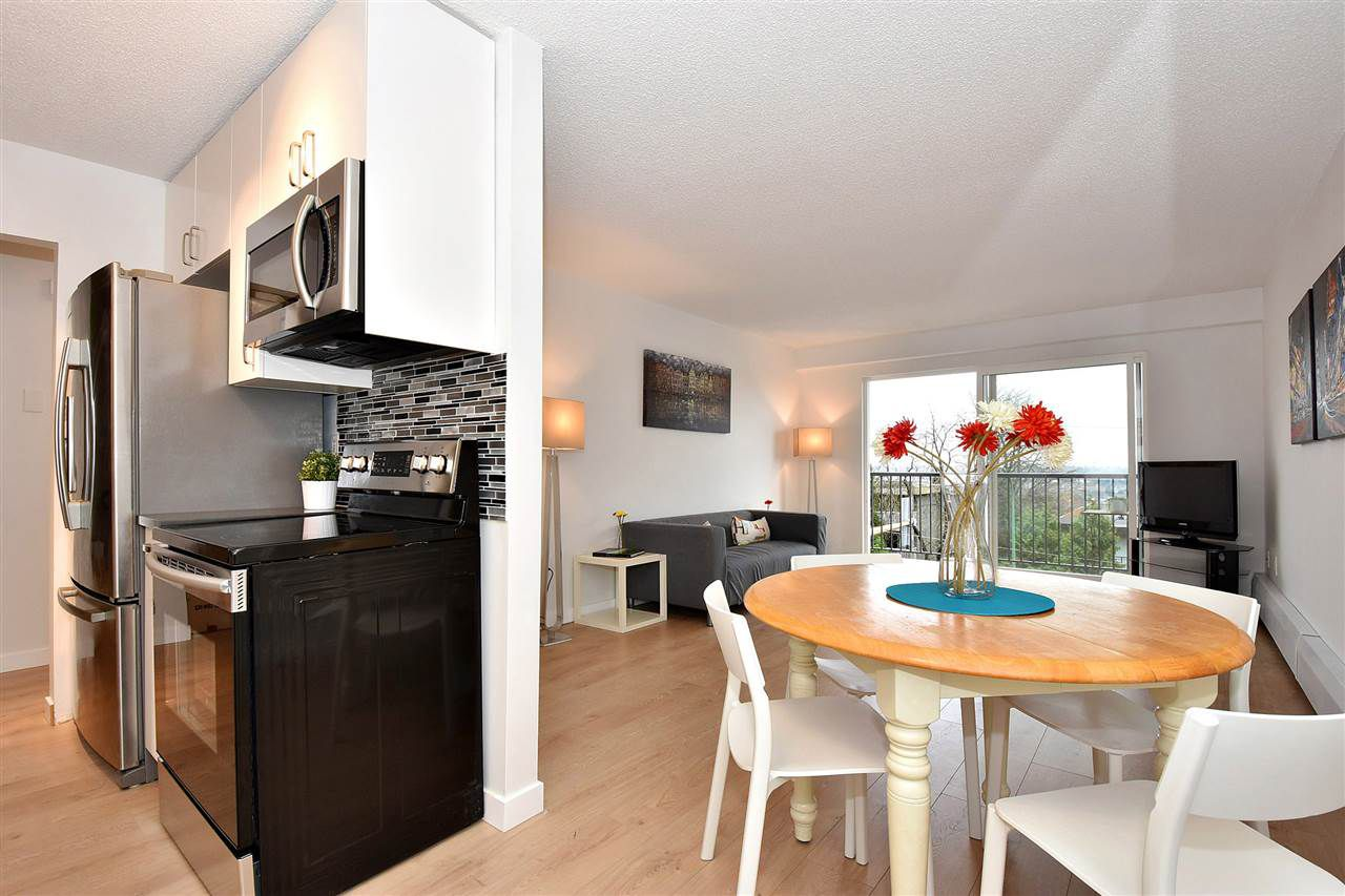 "Main Photo: 210 5450 EMPIRE Drive in Burnaby: Capitol Hill BN Condo for sale in ""EMPIRE PLACE"" (Burnaby North)  : MLS®# R2122966"