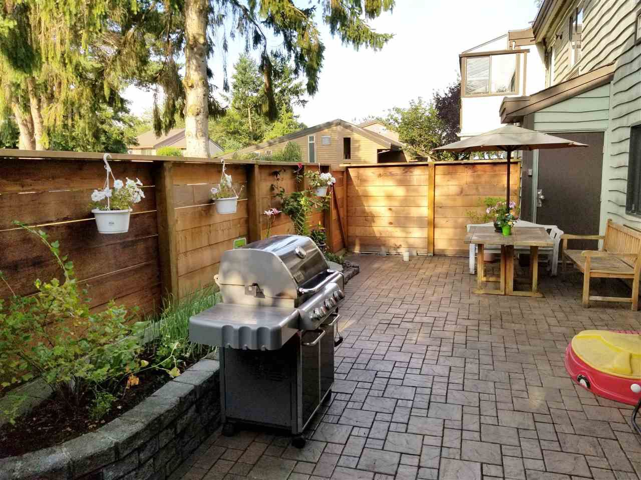 Extra large Patio with Interlocking Stones and Two Storage Sheds and New Fence