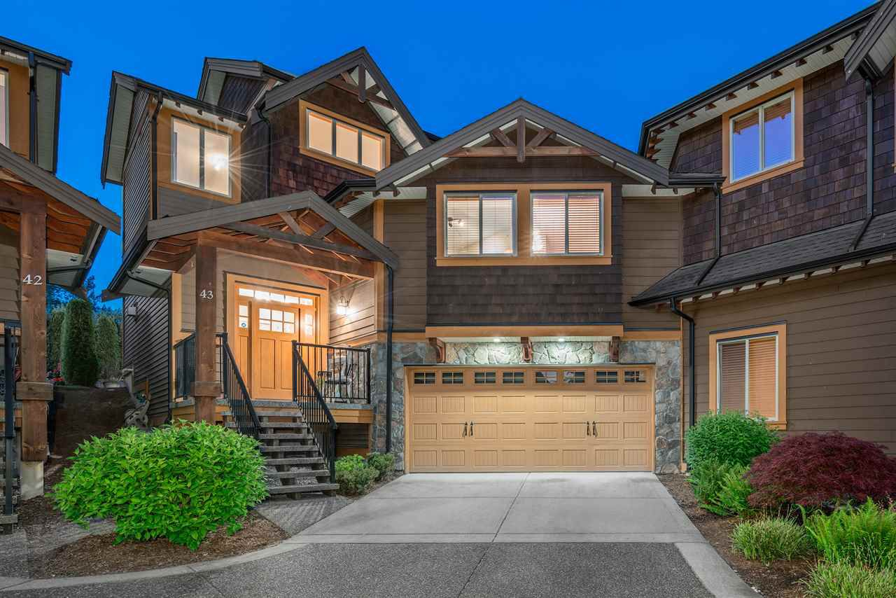 Gorgeous duplex style end unit at Trails Edge, boasting parking for 2 outside, plus an oversize 2 car garage with room for toys.