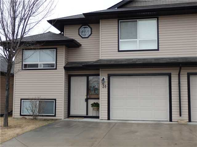 Main Photo: 31 103 FAIRWAYS Drive NW: Airdrie Townhouse for sale : MLS®# C3611153