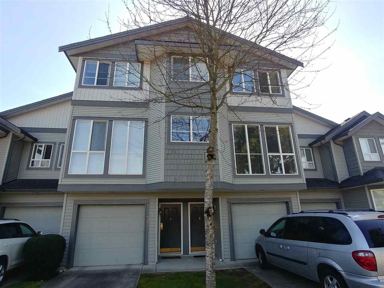 "Main Photo: 38 7250 144 Street in Surrey: East Newton Townhouse for sale in ""Chimney Ridge"" : MLS®# R2339008"