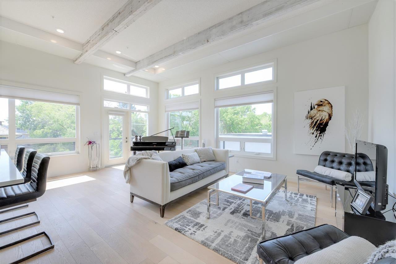Welcome home to PENTHOUSE LUXURY and SOARING 12 foot ceilings!