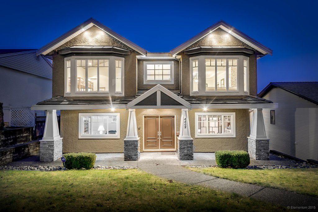 Main Photo: Burnaby South custom home with detach triple garage!