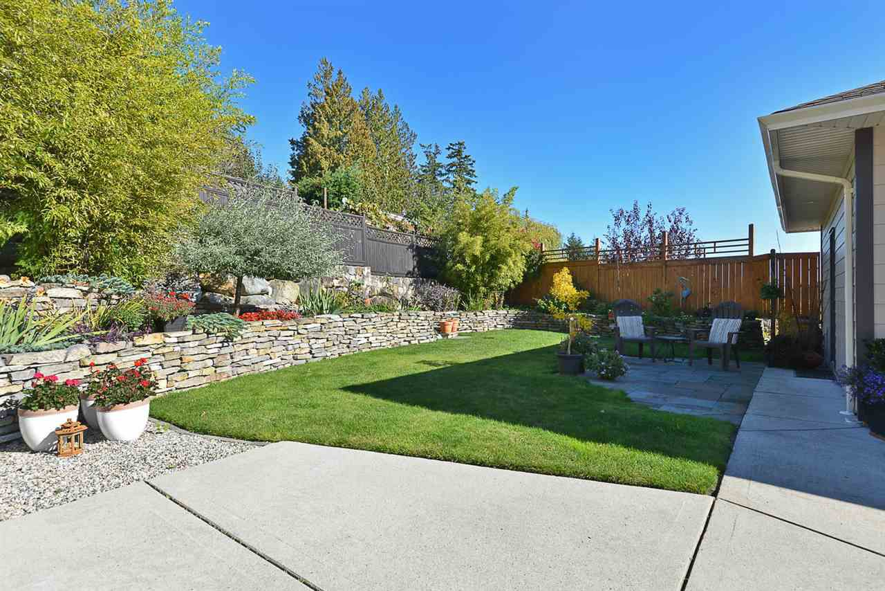 Simply immaculate!  Check out the rock wall, yellow cedar fence, landscaped with vegetable and flower gardens.   Private and quiet for cooling down on those hot summer evenings.
