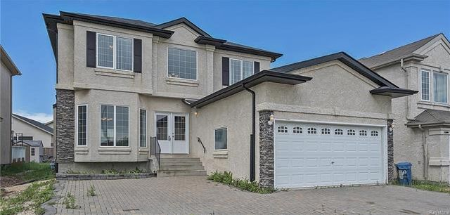Welcome to 118 Strasbourg Drive- With no neighboring property in front of the home, offering a beautiful lake view.