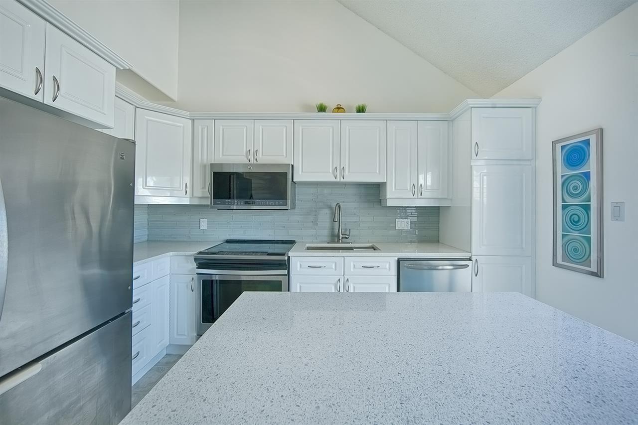 Completely redone with quartz countertops, S/S appliances & mosaic tile backsplash!