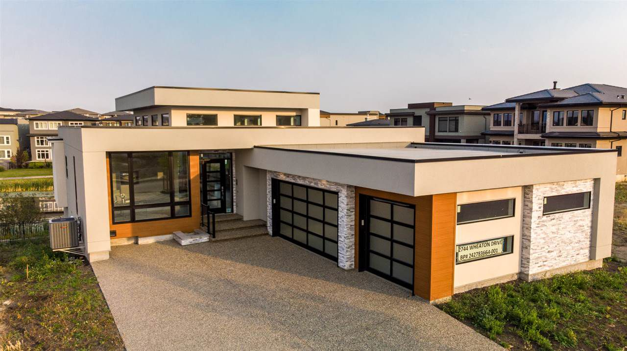 TRUE MODERN DESIGN WITH ACRYLIC STUCCO EXTERIOR, HUGE SUNFILLED TRIPE PANE WINDOWS, FLAT ROOF SBS SYSTEM