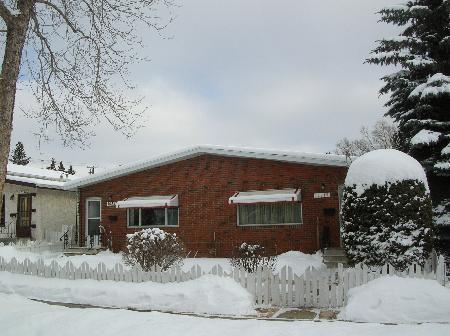 Main Photo: One Half Brick Bungalow Style Duplex