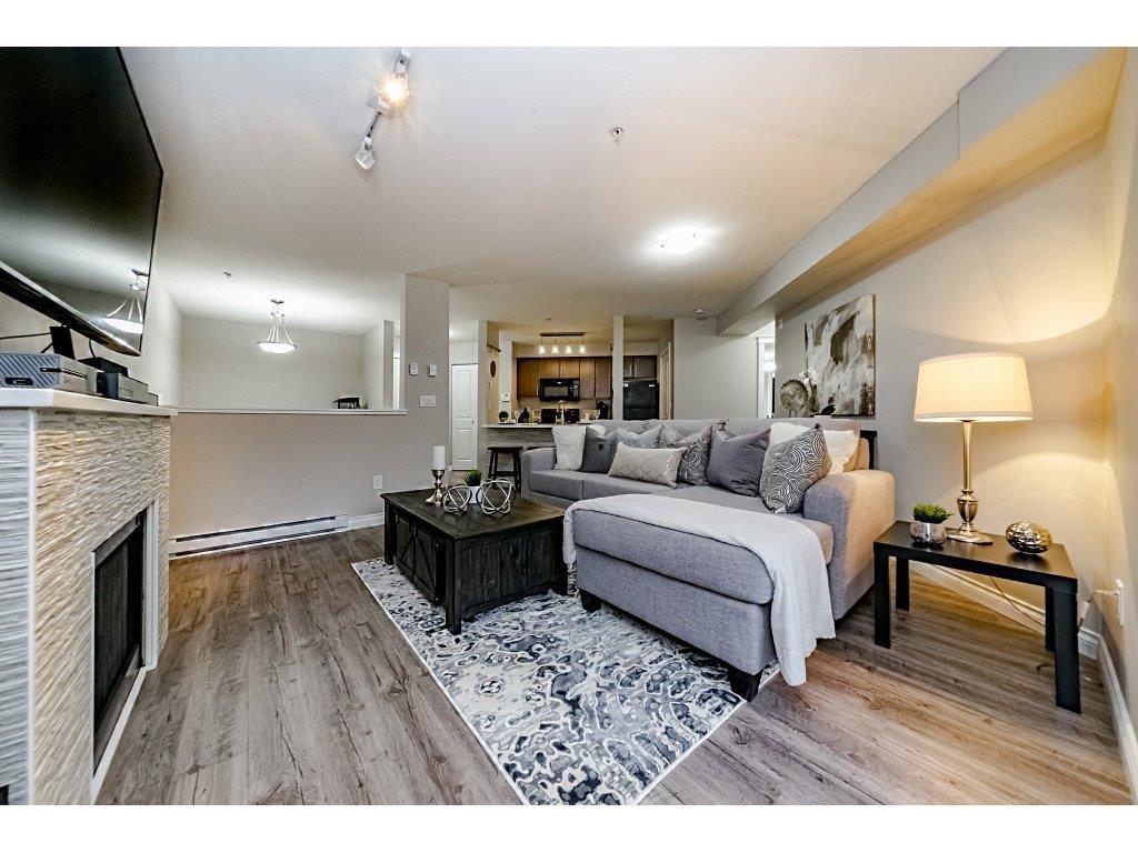 "Main Photo: 127 12238 224 Street in Maple Ridge: East Central Condo for sale in ""URBANO"" : MLS®# R2334476"