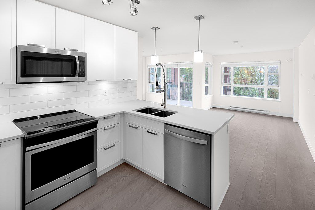 """Main Photo: 205 22562 121 Avenue in Maple Ridge: East Central Condo for sale in """"EDGE ON EDGE 2"""" : MLS®# R2357452"""