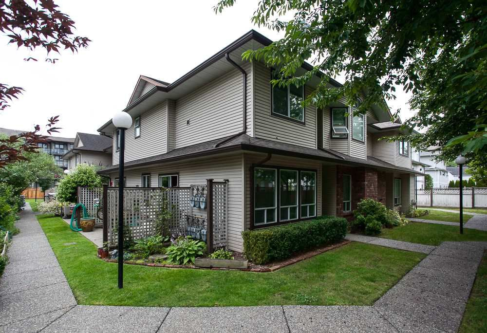 "Main Photo: 107 19908 56 Avenue in Langley: Langley City Townhouse for sale in ""Chenier Place"" : MLS®# R2078671"