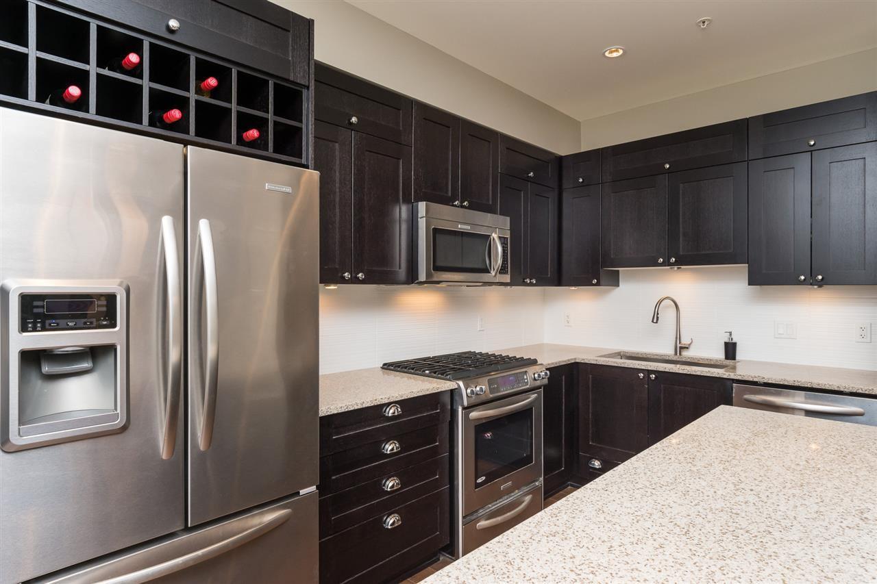 "Main Photo: 103 15145 36 Avenue in Surrey: Morgan Creek Condo for sale in ""EDGEWATER"" (South Surrey White Rock)  : MLS®# R2145908"