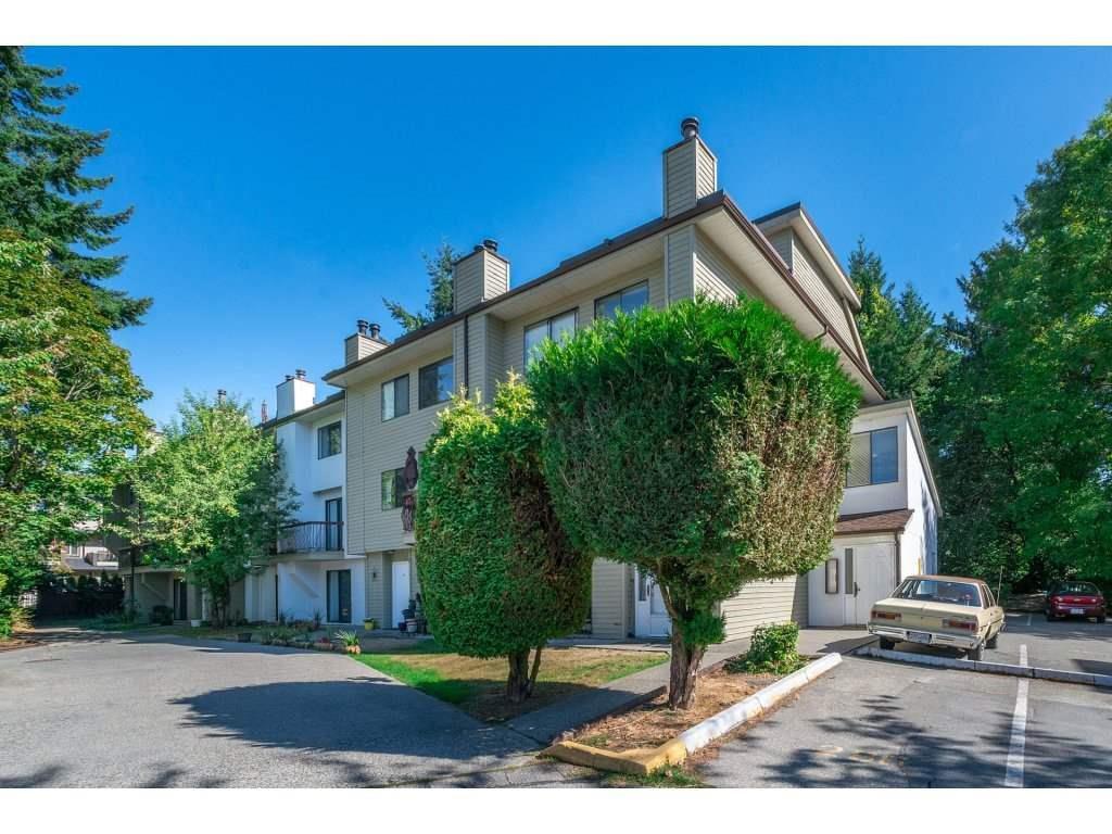 "Main Photo: 105 7144 133B Street in Surrey: West Newton Townhouse for sale in ""Suncreek Estates"" : MLS®# R2311916"