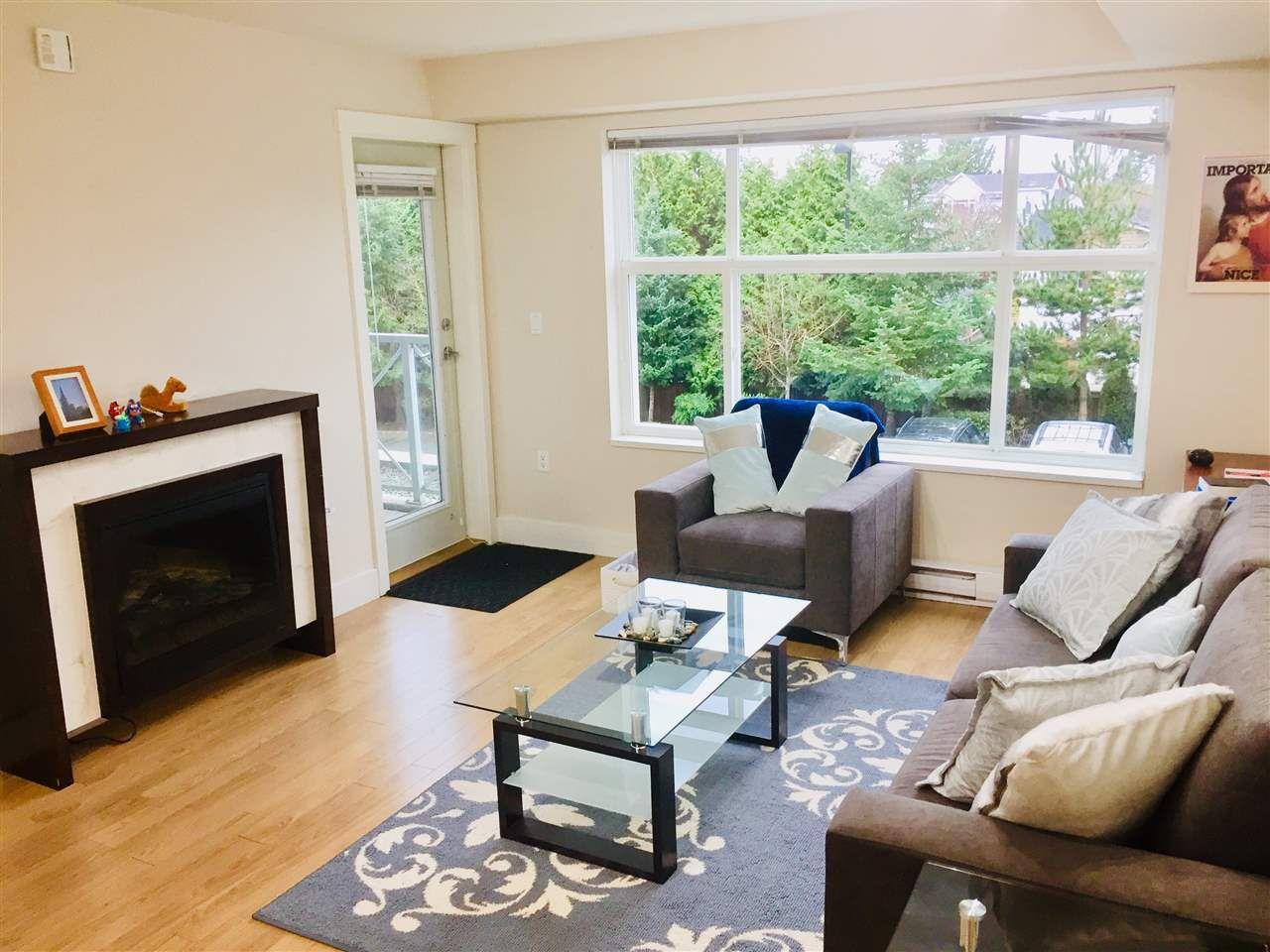 "Main Photo: 216 7445 120 Street in Delta: Scottsdale Condo for sale in ""TREND"" (N. Delta)  : MLS®# R2318437"