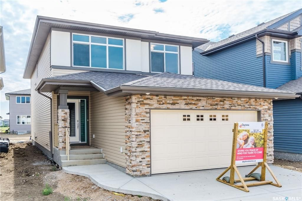 Main Photo: 220 Dagnone Lane in Saskatoon: Brighton Residential for sale : MLS®# SK746511