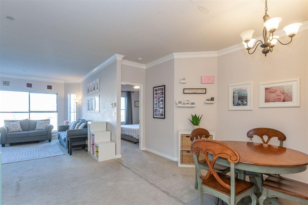 "Main Photo: 308 12464 191B Street in Pitt Meadows: Mid Meadows Condo for sale in ""LASEUR MANOR"" : MLS®# R2364184"