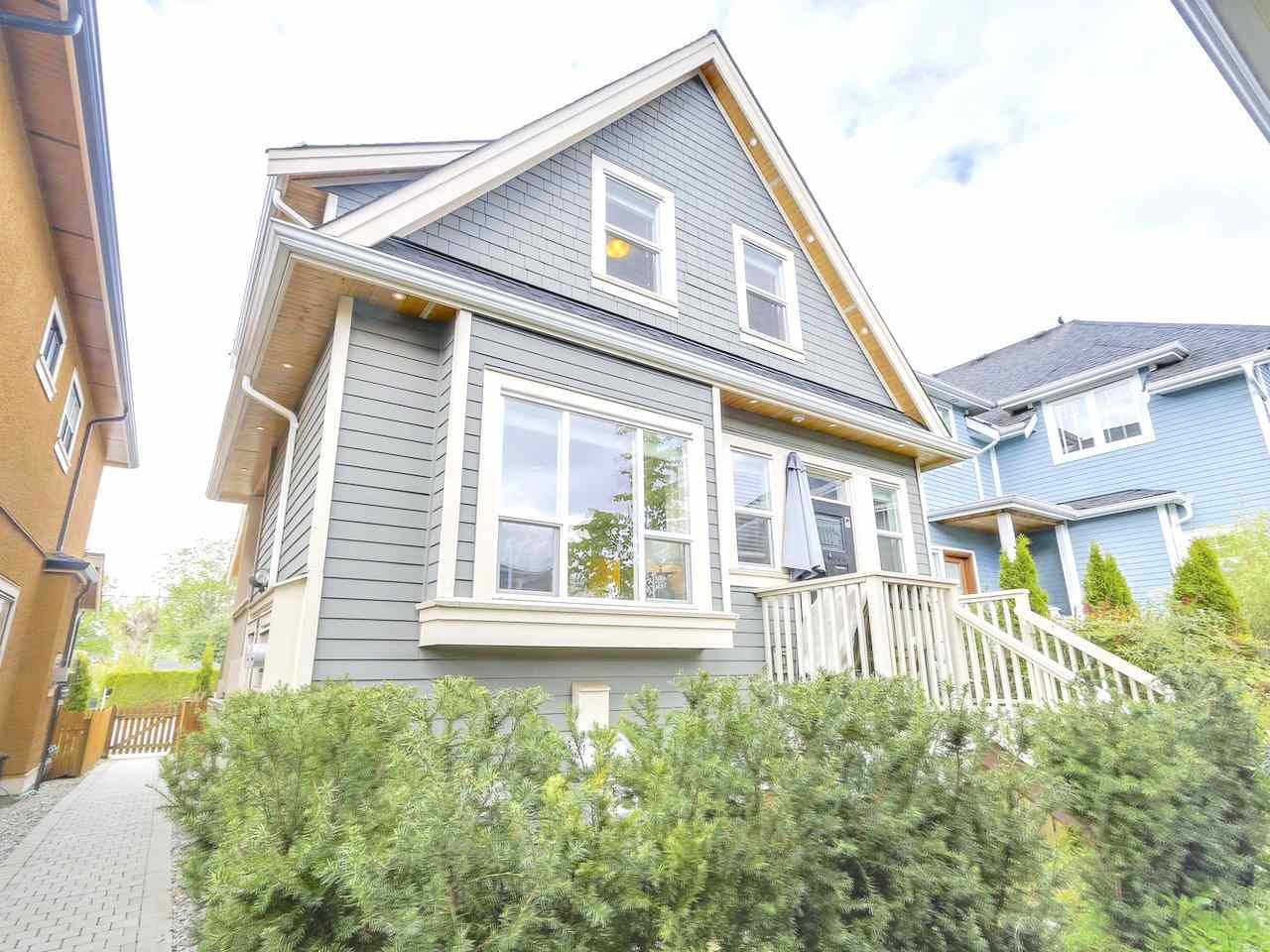Main Photo: 1180 E KING EDWARD Avenue in Vancouver: Knight House 1/2 Duplex for sale (Vancouver East)  : MLS®# R2310356