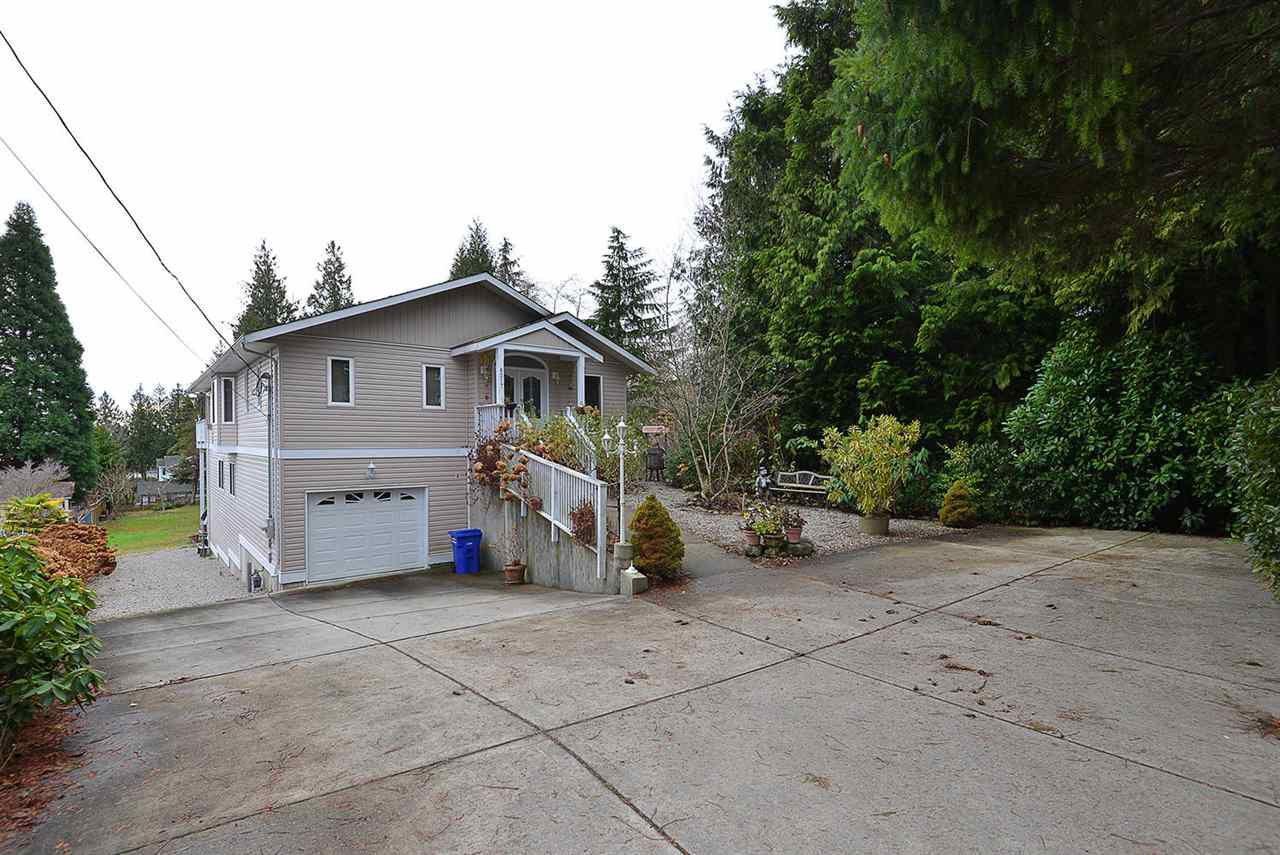 Custom home with lots of parking; attached garage, access to back yard.  Central location in sunny West Sechelt close to schools, churches, bus route and fabulous views.