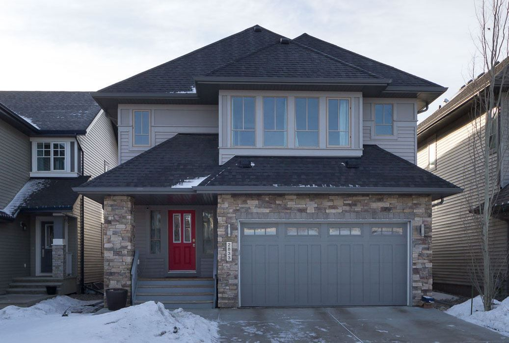 Welcome to 2833 Anderson Place with stone accents and a welcoming front entry.