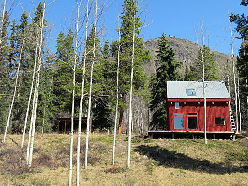 On a treed bench nestled at the base of Munroe Mountain, this home was built by the owner in 1978 from lodgepole pine, white spruce and black spruce all harvested from the property by the owner.  On a concrete foundation with lots of rebar this home is me
