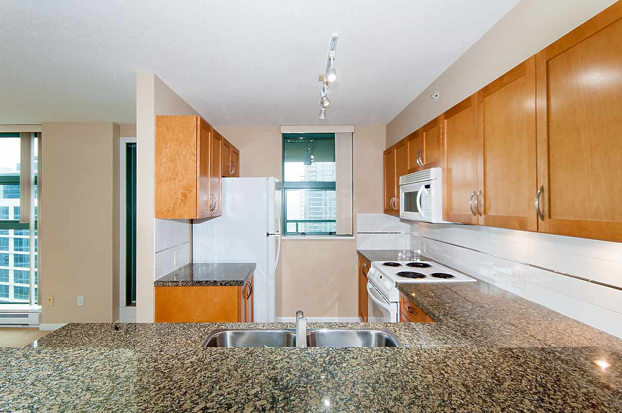 Notice the maple cabinets & granite counter tops. Also there is a window for the chef to enjoy fresh air and views while creating meals.