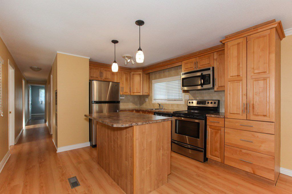 """Main Photo: 82 9080 198 Street in Langley: Walnut Grove Manufactured Home for sale in """"FOREST GREEN ESTATES"""" : MLS®# R2315827"""