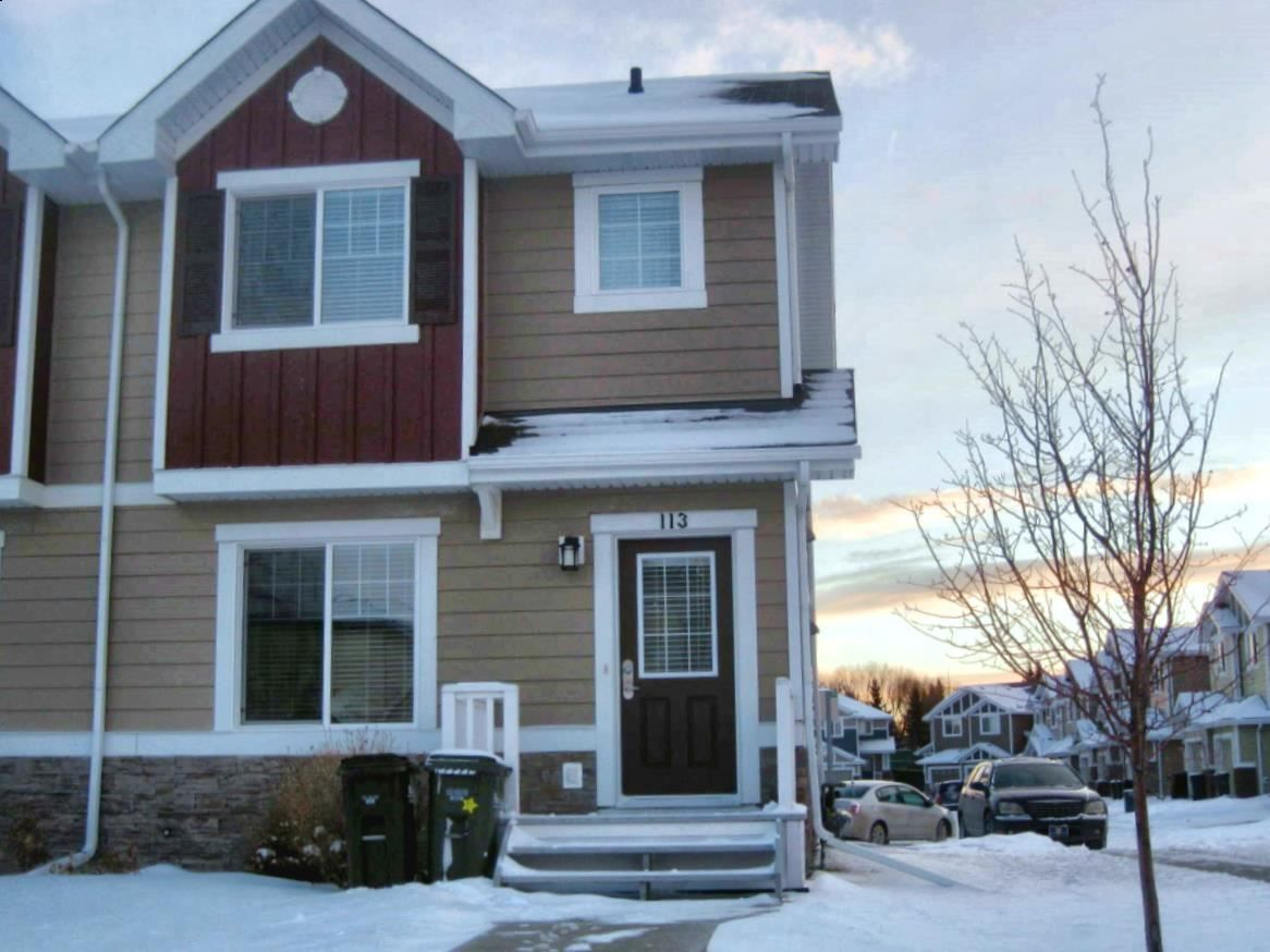 This townhouse faces north and is on a road versus being in the interior of the complex.  Great for additional parking.