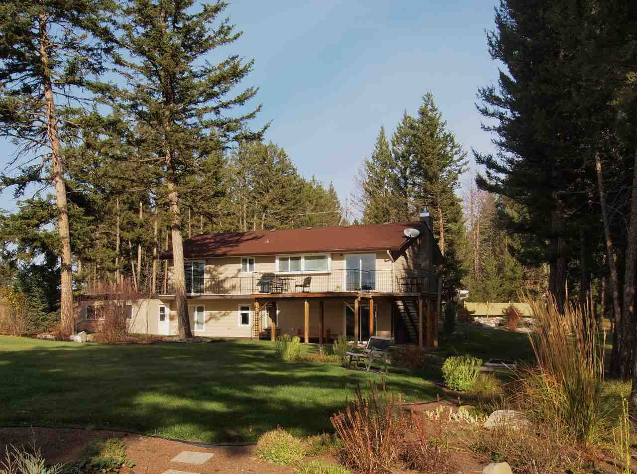 """Main Photo: 4938 GLOINNZUN Crescent in 108 MILE: 108 Ranch House for sale in """"108 RANCH RESORT"""" (100 Mile House (Zone 10))  : MLS®# R2008287"""