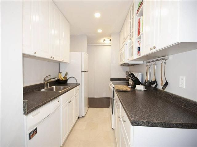 Nicely updated kitchen featuring lots of cabinet space and a pantry closet.