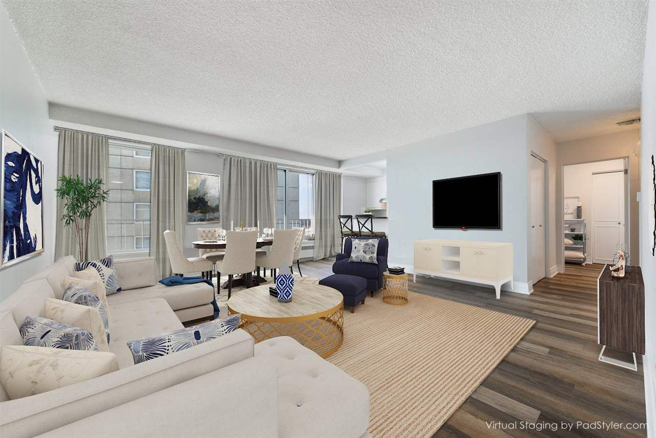 Natural light floods into this top floor unit, thanks to the abundance of windows. Bright, airy, and beautiful! **This photo has been virtually staged**