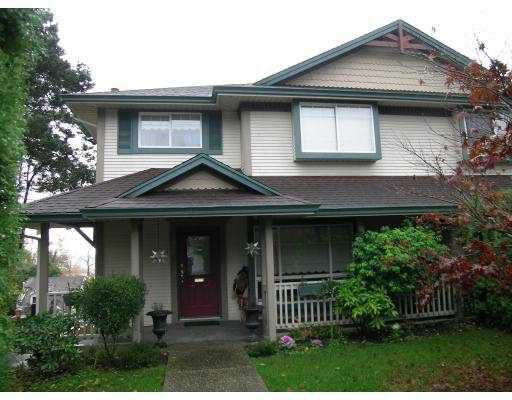 Main Photo: 1052 ALDERSON Ave in Coquitlam: Maillardville House 1/2 Duplex for sale : MLS®# V620992