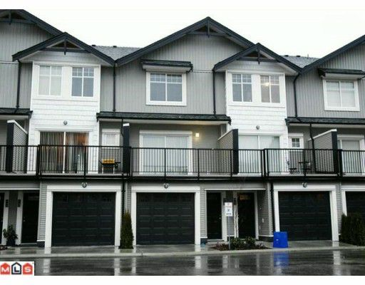 Main Photo: 4 7156 144 Street in Surrey: East Newton Townhouse for sale : MLS®# F1003632