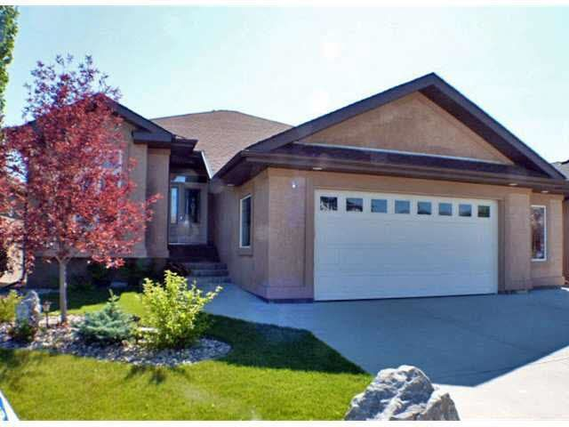 This gorgeous home is truly a must see! Mature trees, professional landscape, water fountain, just absolutely beautiful!