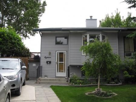 Main Photo: Elegant 3 Bedroom Attached Home