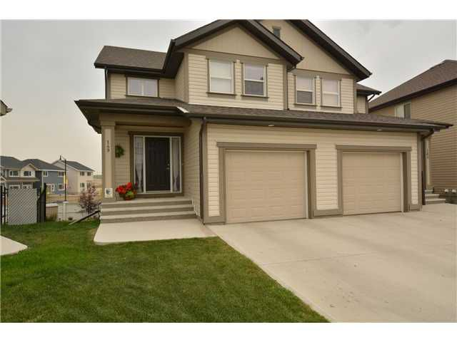 Main Photo: 149 SUNSET Common: Cochrane Residential Attached for sale : MLS®# C3631506