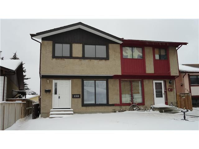 Main Photo: 158 ABALONE Place NE in CALGARY: Abbeydale Residential Attached for sale (Calgary)  : MLS®# C3558137