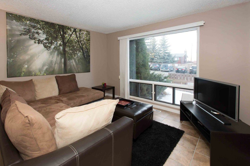 Main Photo: Condo for Sale in Southwest Calgary Palliser