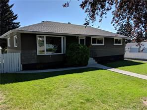 Main Photo: 5904 Tipton Rd NW in Calgary: Thorncliffe House  : MLS®# c4195318