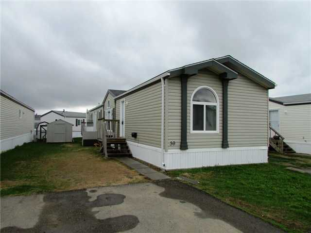 """Main Photo: 59 9203 82ND Street in Fort St. John: Fort St. John - City SE Manufactured Home for sale in """"THE COURTYARD MHP"""" (Fort St. John (Zone 60))  : MLS®# N227820"""