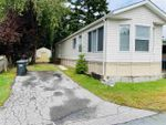 Main Photo: 87 40157 GOVERNMENT Road in Squamish: Garibaldi Highlands Manufactured Home for sale : MLS®# R2399820