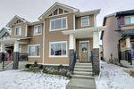 Main Photo: 105 Heartland Boulevard: Cochrane Semi Detached for sale : MLS®# A1042872