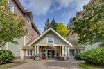"Main Photo: 105 9650 148 Street in Surrey: Guildford Condo for sale in ""Hartford Woods"" (North Surrey)  : MLS®# R2490109"