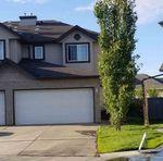 Main Photo: 144 CASTLE Drive in Edmonton: Zone 27 House Half Duplex for sale : MLS®# E4201136