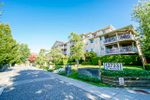 """Main Photo: 216 13733 74 Avenue in Surrey: East Newton Condo for sale in """"King's Court"""" : MLS®# R2495227"""