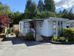 "Main Photo: 13 4200 DEWDNEY TRUNK Road in Coquitlam: Ranch Park Manufactured Home for sale in ""HIDEAWAY PARK"" : MLS®# R2475292"