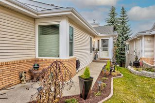 Photo 2: 1062 Shawnee Road SW in Calgary: Shawnee Slopes Semi Detached for sale : MLS®# A1055358