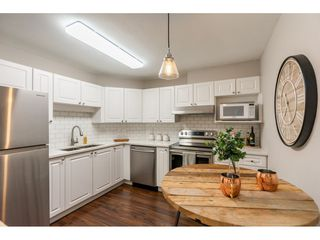 "Photo 9: 210 5977 177B Street in Surrey: Cloverdale BC Condo for sale in ""THE STETSON"" (Cloverdale)  : MLS®# R2482496"