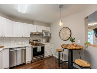 "Photo 8: 210 5977 177B Street in Surrey: Cloverdale BC Condo for sale in ""THE STETSON"" (Cloverdale)  : MLS®# R2482496"