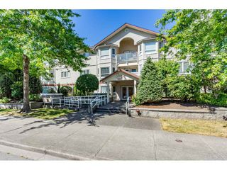 "Photo 1: 210 5977 177B Street in Surrey: Cloverdale BC Condo for sale in ""THE STETSON"" (Cloverdale)  : MLS®# R2482496"