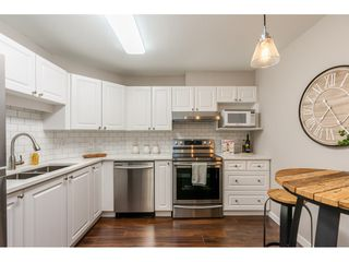 "Photo 7: 210 5977 177B Street in Surrey: Cloverdale BC Condo for sale in ""THE STETSON"" (Cloverdale)  : MLS®# R2482496"